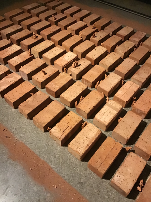 The Work is an installation made of clay bricks and mice